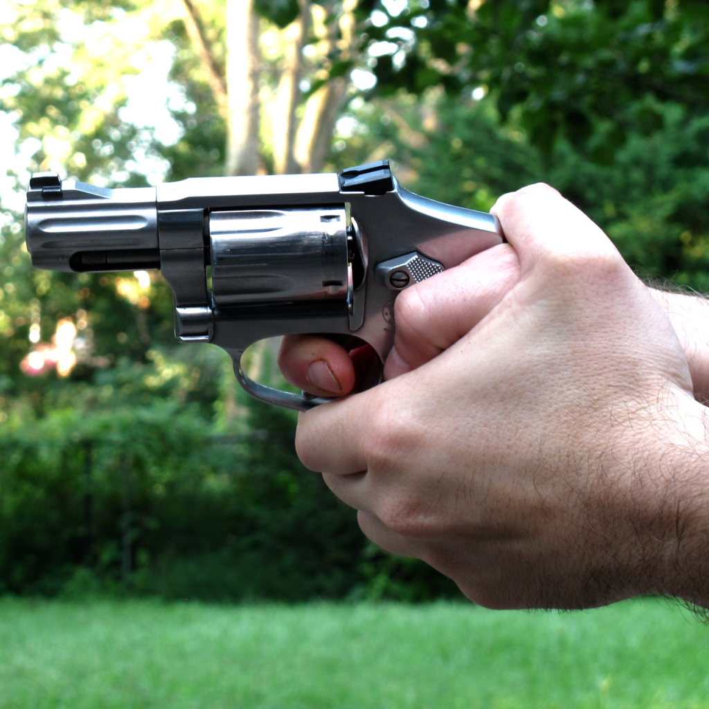 Thumbs Forward Revolver Grip
